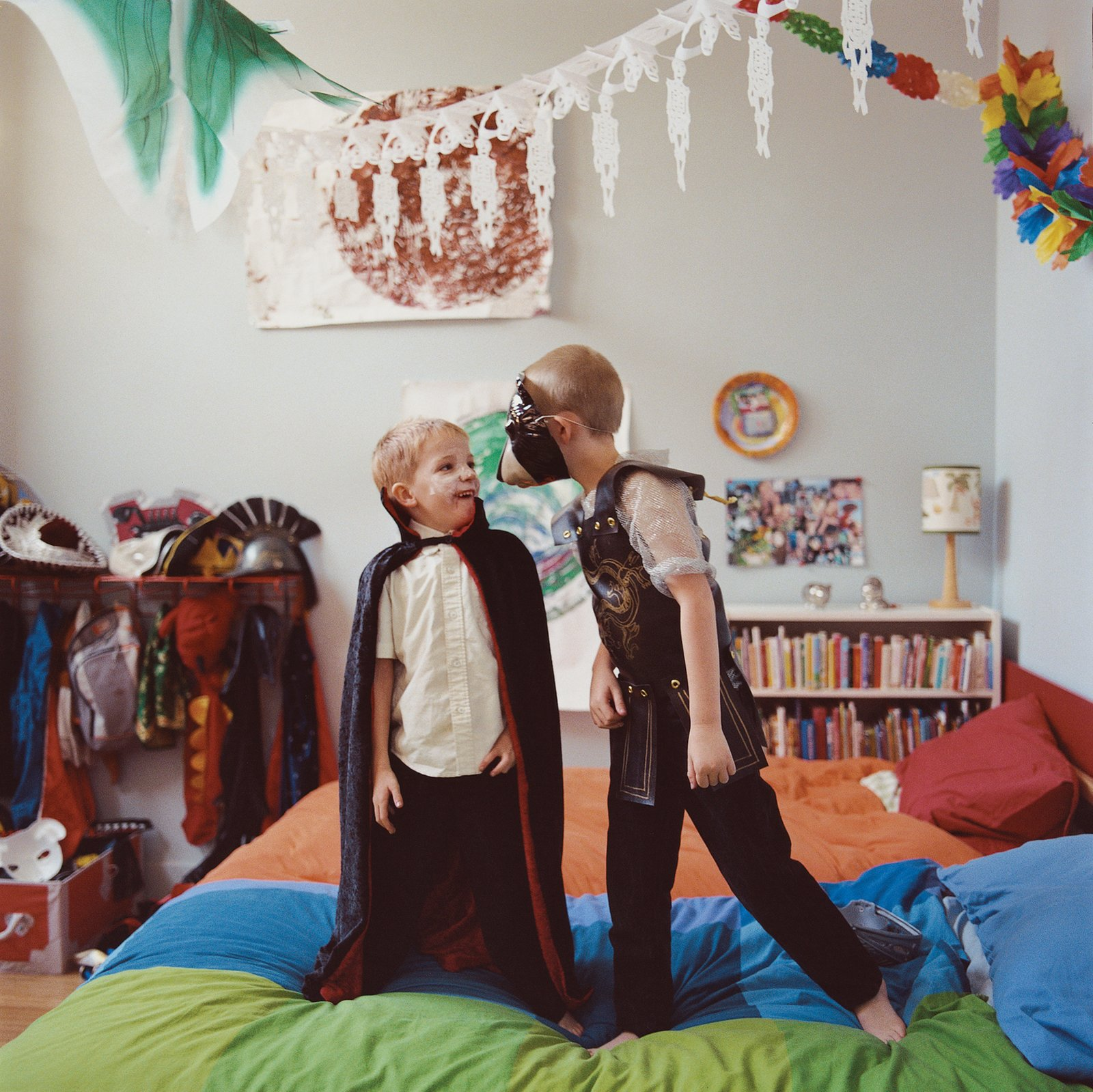 """in a loft in L.A.'s Chinatown, Moe and Lewis play in their shared bedroom, the former Madame Wong's kitchen. """"It's just so fun for them to live in a funny place like this,"""" says Amy. """"Their friends love to come over and play."""""""