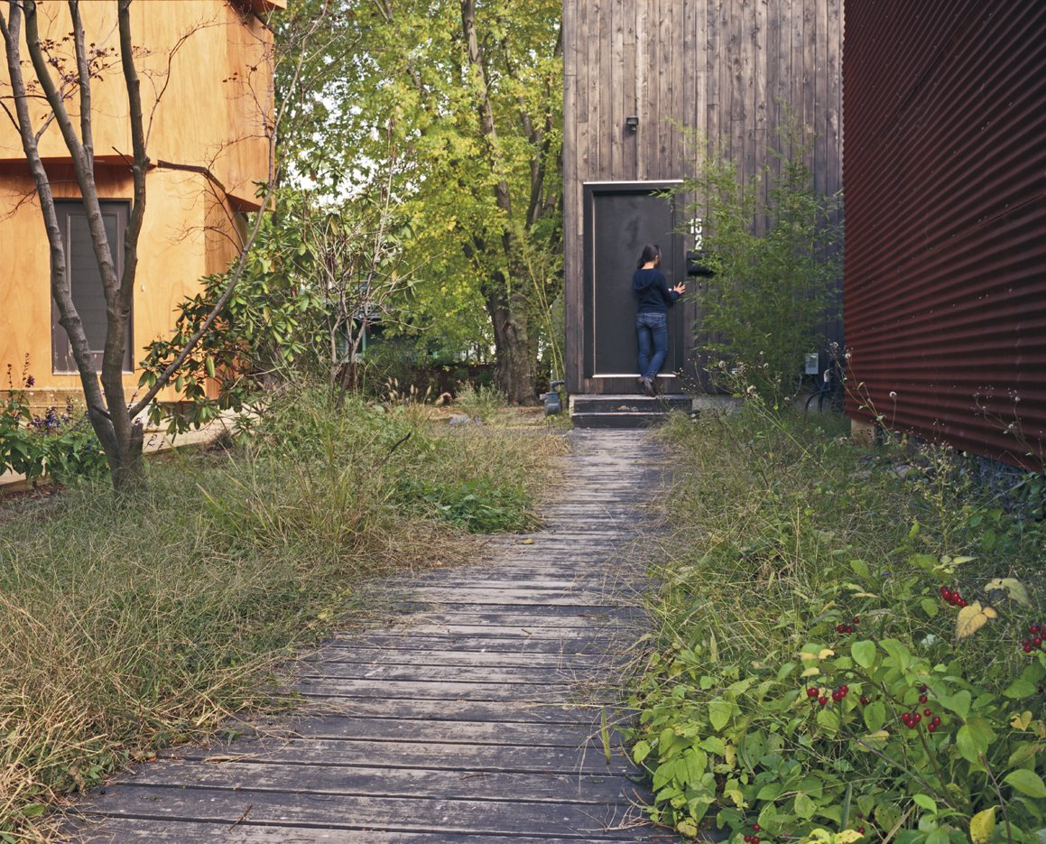 The overgrown boardwalk leading up to Medium's entrance feels more Martha's Vineyard than North Cambridge. Four Houses and a Future - Photo 3 of 11