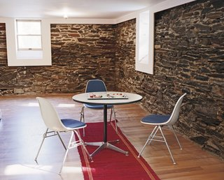 Schenk discovered native flagstone in the basement of Large when they tore away the old wood wall lining, and fell in love with its rough and cool exterior.