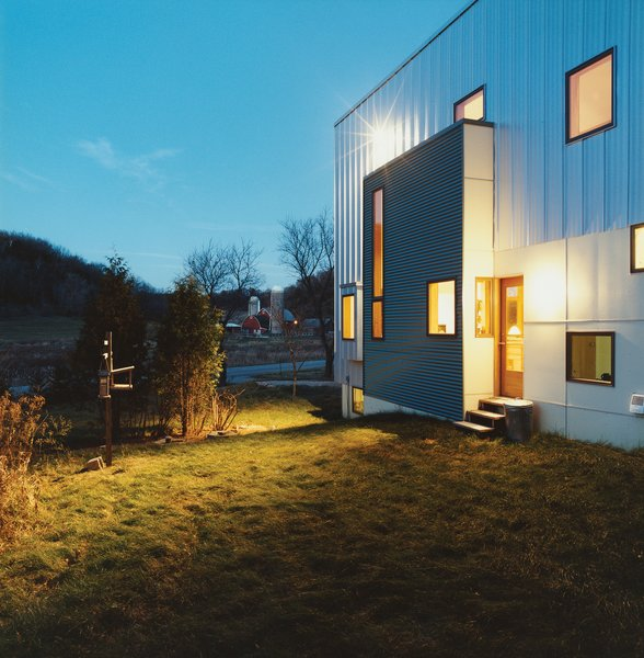 The rear of the house, which could have been treated as an afterthought given the project's minimal budget, is instead a lively essay in form and color.