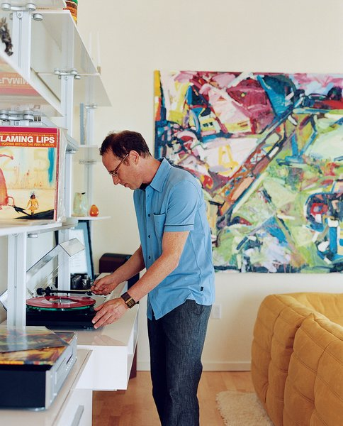 Randy Rapaport can't get enough of his favorite band, the Flaming Lips, and happily whiles away the hours spinning their records in his 1,000-square-foot loft. On the wall is a painting by Timothy Scott Dalbow that Rapaport picked up from the nearby New American Art Union Gallery.
