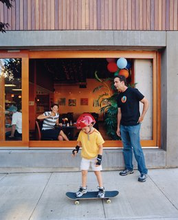 Resident Brooks Jordan and his son Leif take some time out to play outside the Belmont, where a steady stream of pedestrians and diners lend the building an inviting feel.