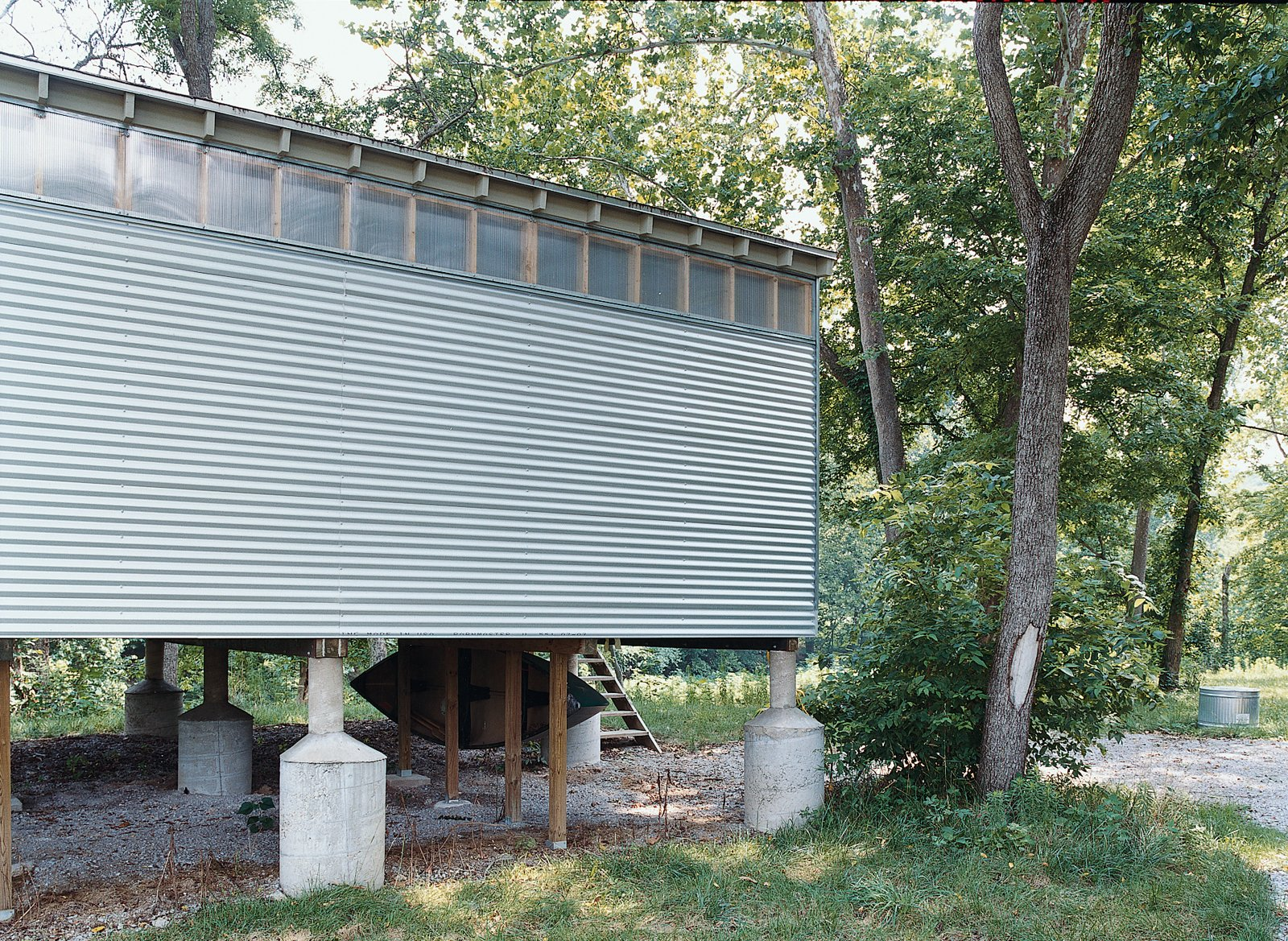 The creekside Fish Camp prototype rests on oversize flood-rated pylons, one of many foundation options the Camp units can accommodate. Tagged: Exterior, Metal Siding Material, House, and Cabin Building Type.  Photo 10 of 10 in All You Need Is LV