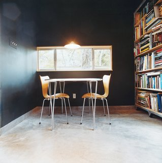 These 3107 chairs and Superellipse table are from Fritz Hansen.