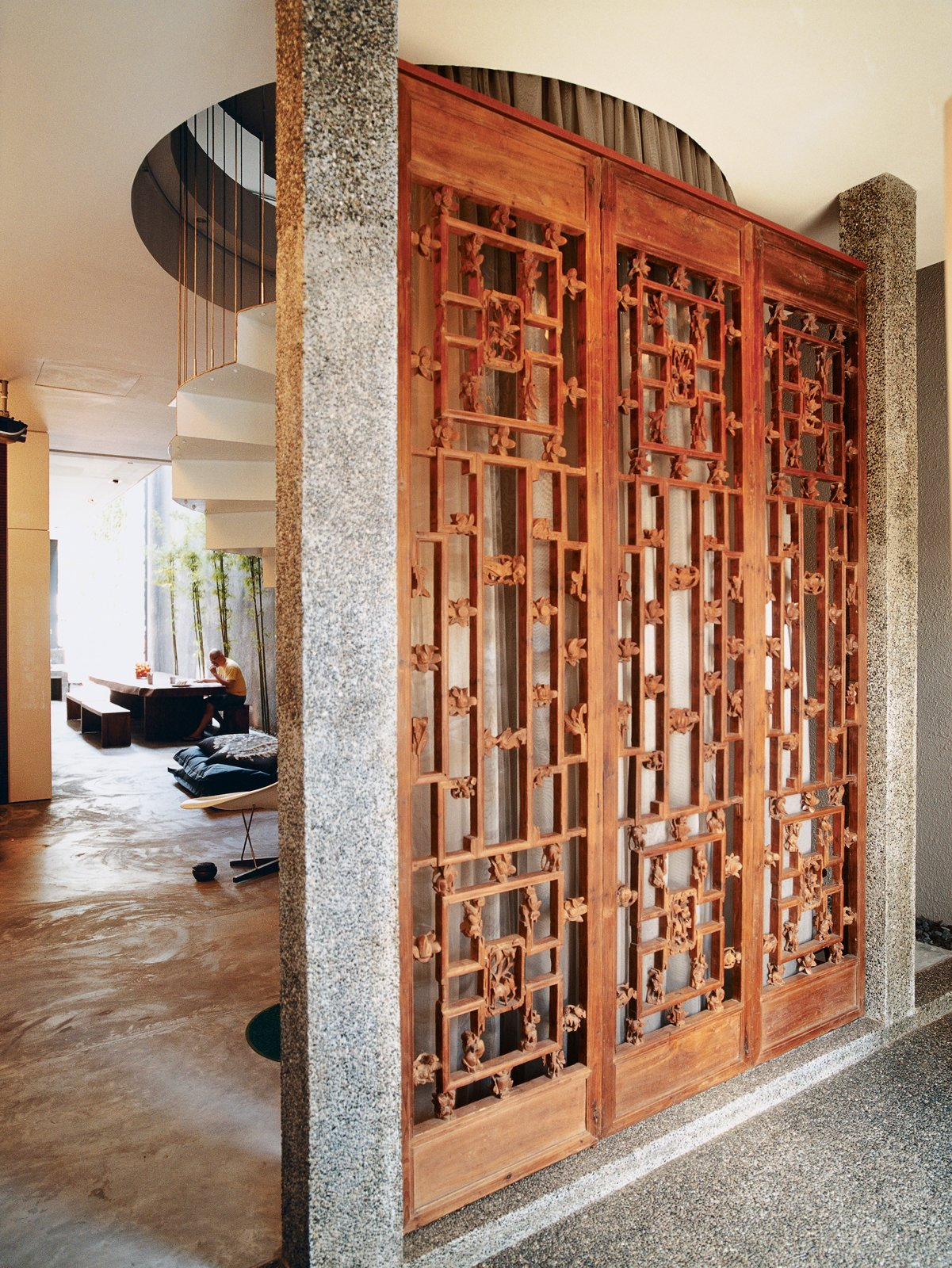 Once inside, visitors are greeted by three ten-foot-tall hand-carved antique panel doors. Tagged: Doors, Wood, Swing Door Type, and Interior.  Photo 2 of 9 in Straight and Narrow