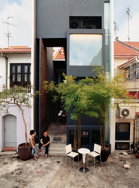 """Yang Yeo and his girlfriend Ching Ian relax on the back stoop of their renovated and radically updated Singapore shophouse—an archetypal building type in this busy port city. """"Shophouses brought back memories of our childhood,"""" says Yeo."""
