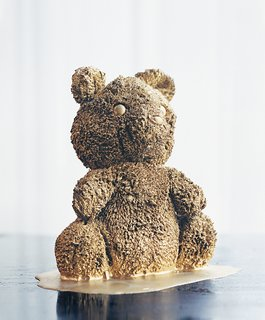 A gold-plated porcelain teddy bear.