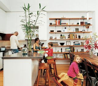 Row House Revival - Photo 5 of 8 - The Ogrodnik/Bardin family enjoy the pleasures of family life in the kitchen.