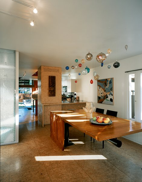 In the dining/kitchen area there are cabinets and floors made of oriented strand board (OSB) and a cherry dining table fabricated by Joe Cooper to the architects' design.