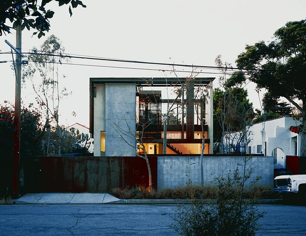 Brooks and Scarpa took an unlovable old bungalow that occupied a deep through lot, with streets front and rear, and transformed it into their dream home. The ingenious new solar-framed façade is seen here.