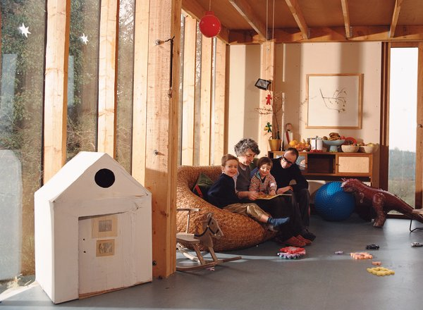 In the living room, the vertical timber columns that support the roof are in plain sight. Stevens wants his children to understand how their house stands up. His building method was partly inspired by Walter Segal, a mid-20th-century German architect who spent most of his life in London.