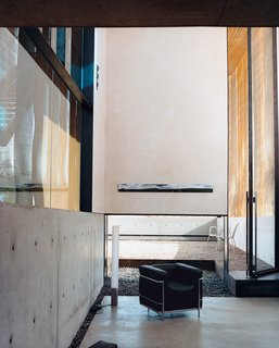 Xeros Effect - Photo 4 of 7 - In a portion of the living area, Le Corbusier's LC2 chair is set alongside Pablo Pardo's Elise lamp.