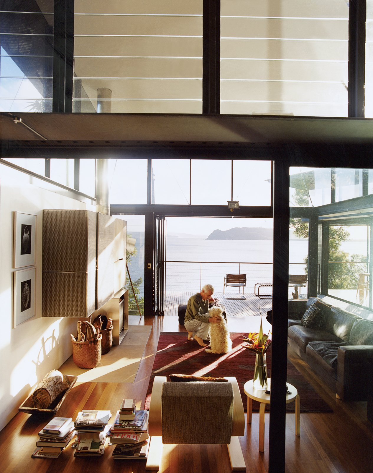 The living room structure soars to two stories, with banks of glass louvers at the upper level providing cross ventilation. Tagged: Living Room.  Photo 4 of 11 in Three Glass-and-Copper Pavilions Conquer the Cliffs