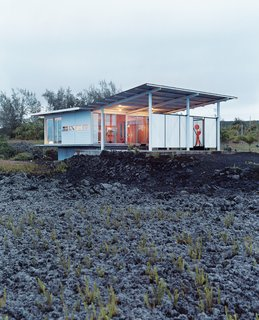These 7 Hawaiian Modernist Escapes Will Have You Dreaming of the Islands - Photo 1 of 7 - An architect and his family swapped their fast-paced San Francisco city life for slow living and sunshine along the ever-expanding Puna coastline of Hawaii's Big Island in this home designed by architect Craig Steely.