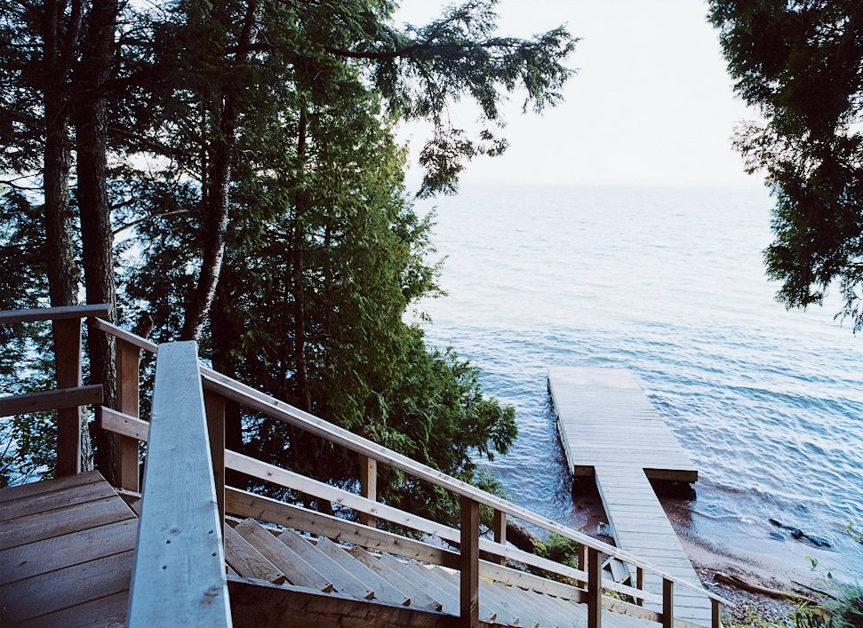 A wooden stair leads from the house down to a dramatic view of Lake Superior.  Photo 5 of 10 in Off the Beaten Path
