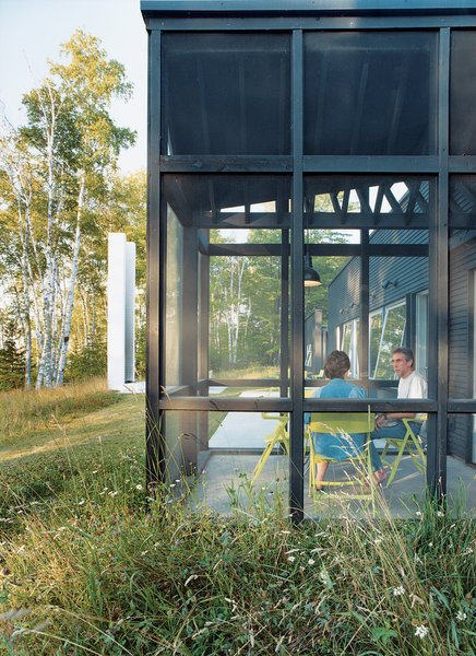 """""""Every room except the bath has huge windows."""" explains Bruce Golob. """"And although David was reluctant to design a screen porch he figured out a way to do it without interfering with any of the views.""""  Photo 6 of 10 in Off the Beaten Path"""