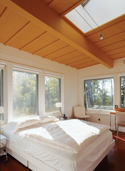 Skylights and huge windows flood the master bedroom—and every room in the house—with sunlight. Bed by Techline; lighting by Tech Lighting.