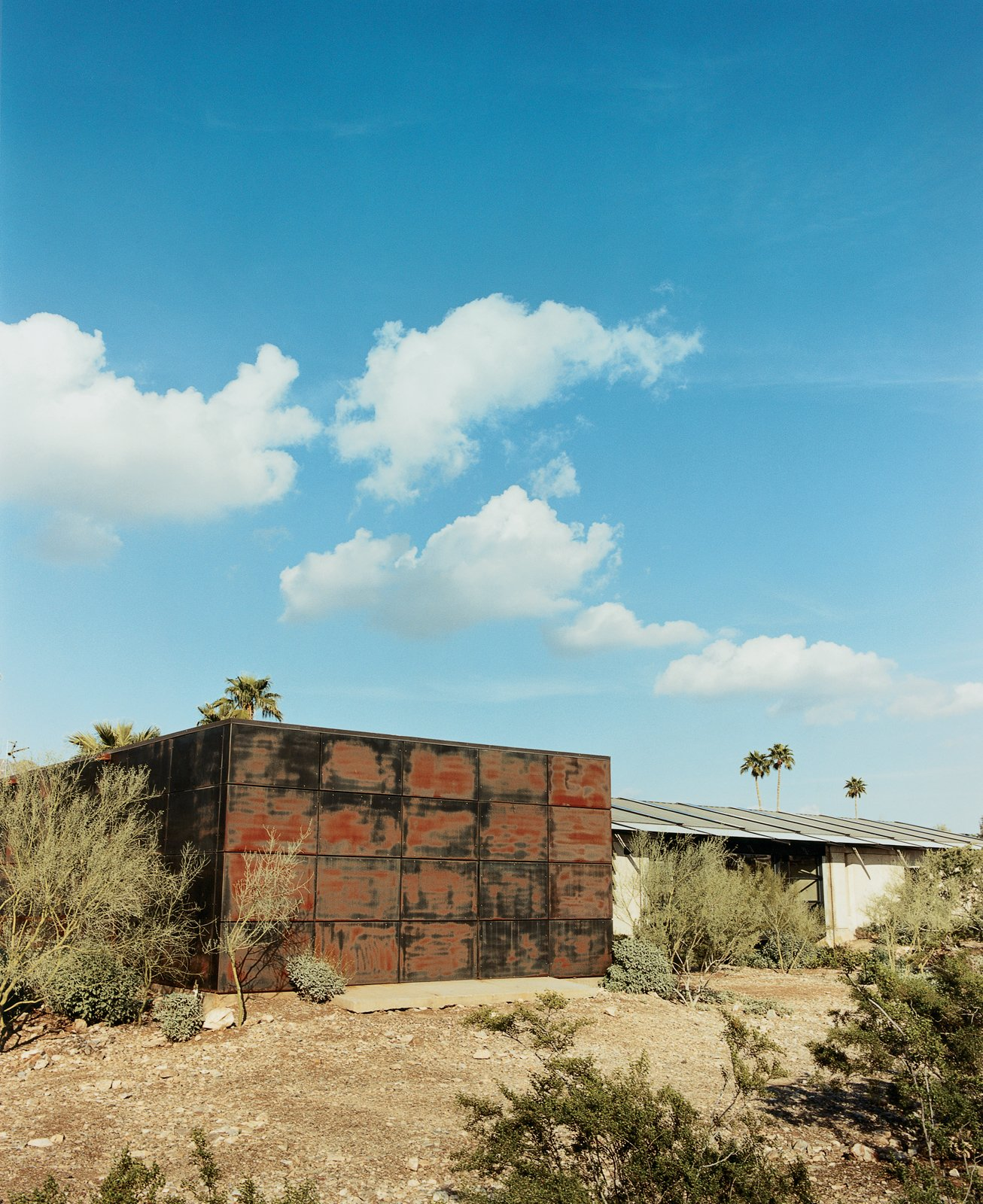 The metal shed, where Lisa Sette and her husband lived temporarily, was featured on the cover of Dwell's first issue.  Desert Homes by Heather Corcoran from Love's Labors Found