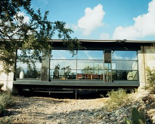 Love's Labors Found - Photo 5 of 11 - The plan is simple: Two rectangles are connected by a bridge that traverses a desert wash. The effect of the light shining into the glass-walled living room is what first attracted Sette and Shikany to the house.