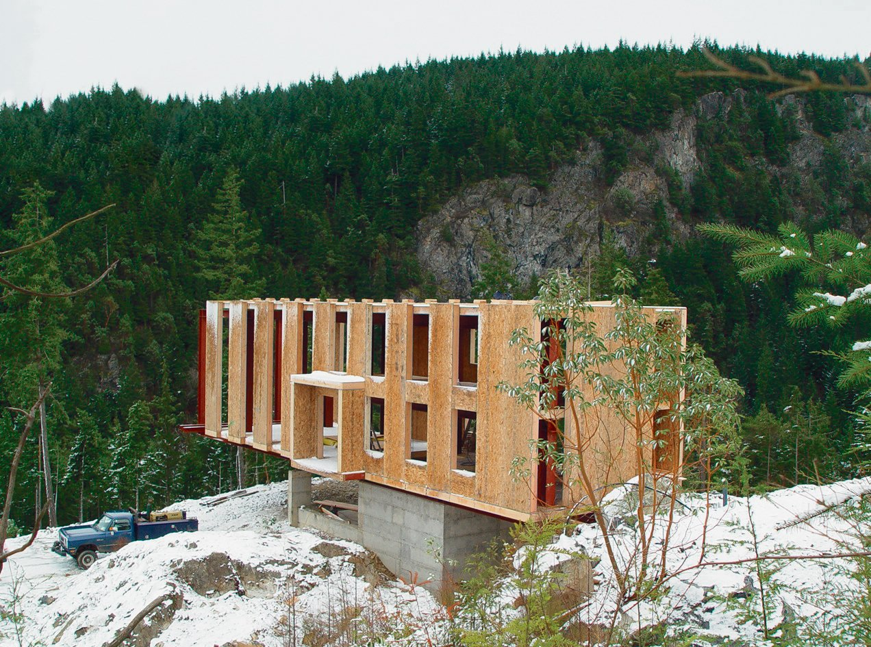 "The use of structural insulated panels (SIPs) throughout the house helped speed the construction process. Peter Anderson explains, ""The panels themselves hang from and rest upon the steel frame and wood spline beam system, which is the link between the steel frame and the panels. The SIPs provide enclosure, insulation, and the spanning capacity to support the cast-concrete floor.""  Photo 3 of 10 in On a Rock in a Hard Place"