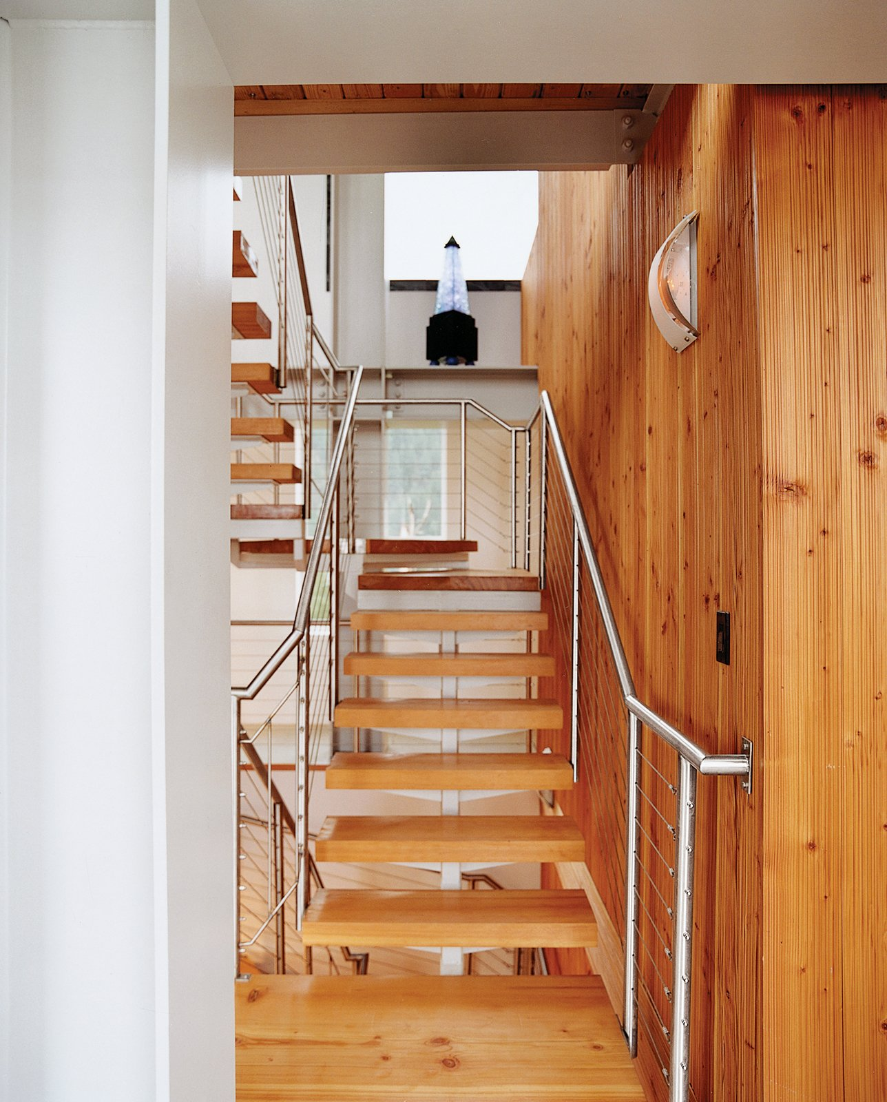 The stairs and the wood paneling were designed and built by wood-worker Noah Israel, a longtime neighbor and friend.  Photo 7 of 10 in On a Rock in a Hard Place