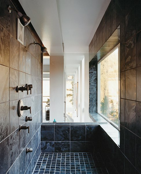 The master bath features a tiled shower—an optimal spot for viewing the intense weather.