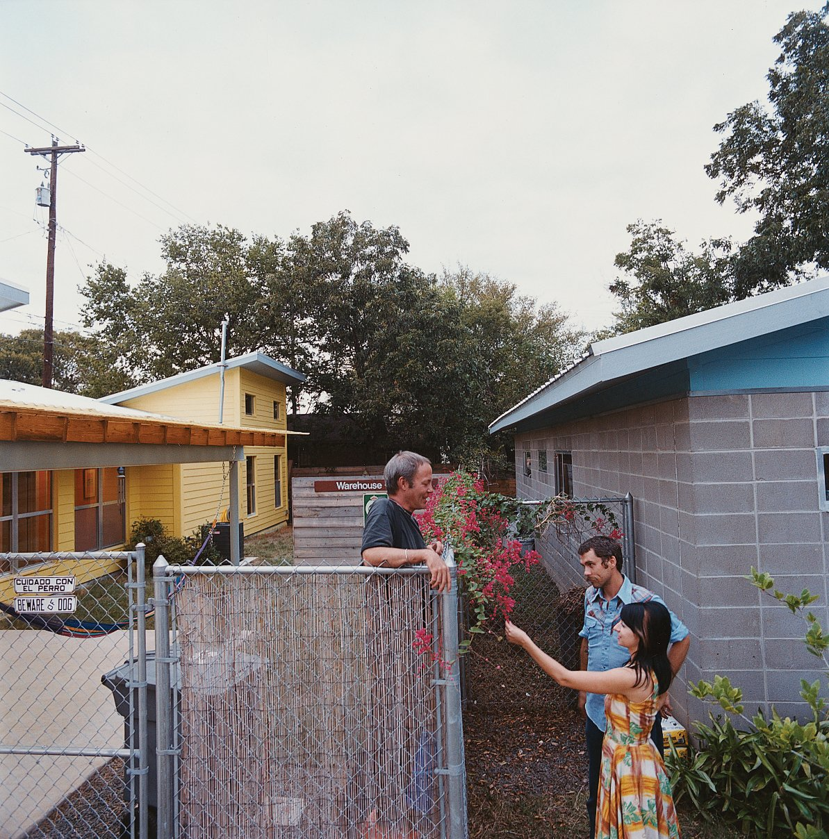 Andy and Regina greet their neighbor Dan Morris, owner of the Beckham-designed house.  Photo 4 of 5 in A Lot for a Little