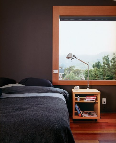 The master bedroom faces Montara's coastal mountains. The Tolomeo lamp is by Artemide.