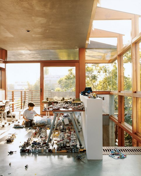 Sustainability in Stages - Photo 1 of 6 - In the new addition to the Hertz/Fong residence, the architect's son Max tinkers with his extensive array of Legos and War Hammer miniatures in the upstairs office/playroom.