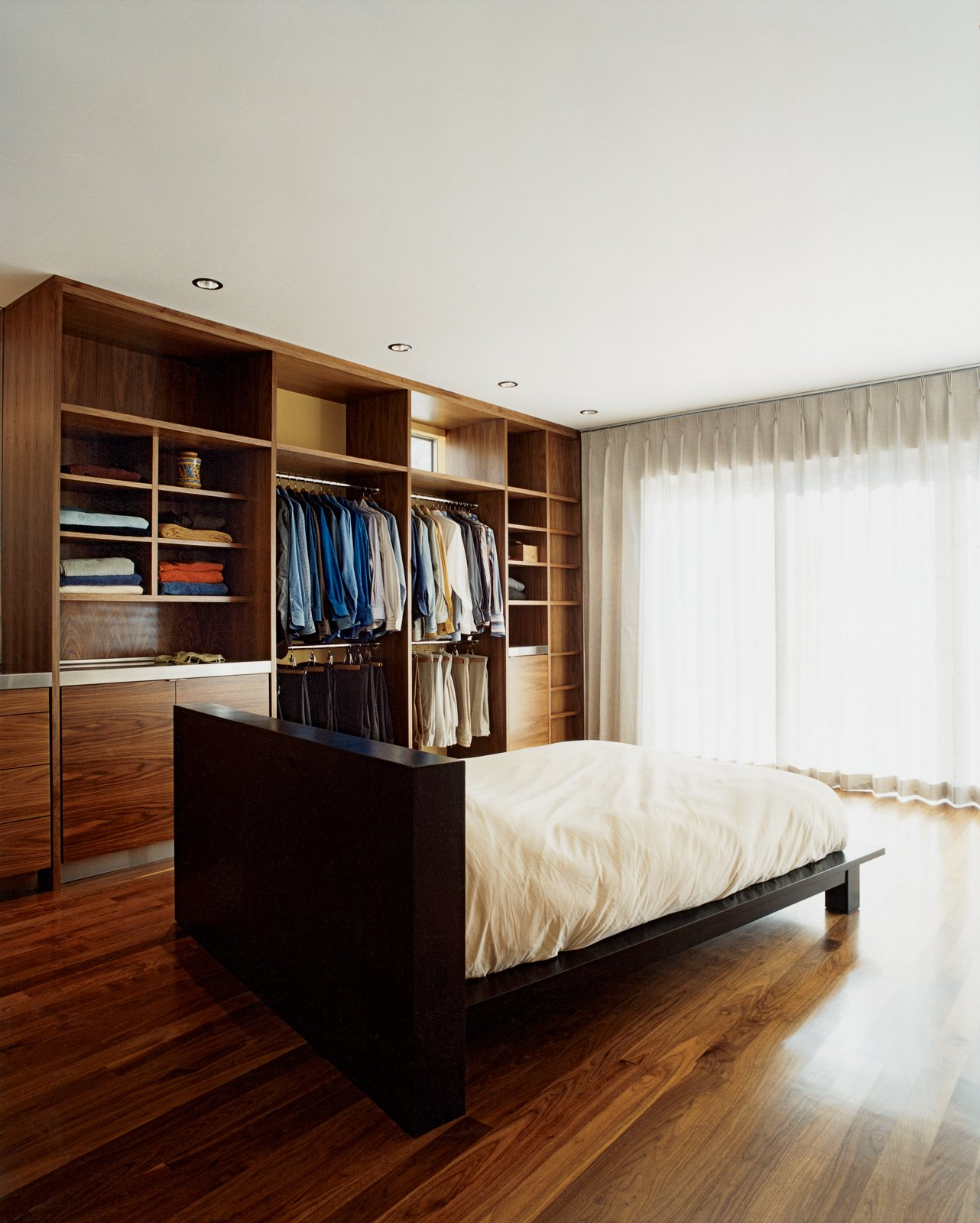"""The master bedroom.  """"The small size of the home inspired me to design it as an  urban retreat for casual living based on radical simplicity,"""" says architect Cass Calder Smith."""