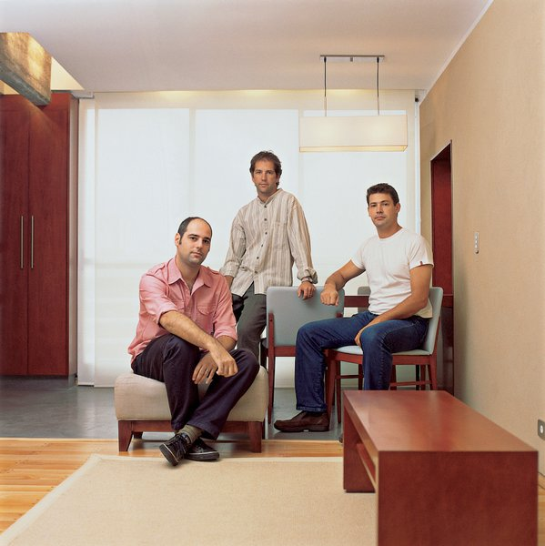 "Architects Sebastian Weisz, Martin Chatruc, and Javier Leibovich of ChLW, shown here in their studio.Of Buenos Aires, Weisz says, ""You can always discover new things here. It happens all the time."""