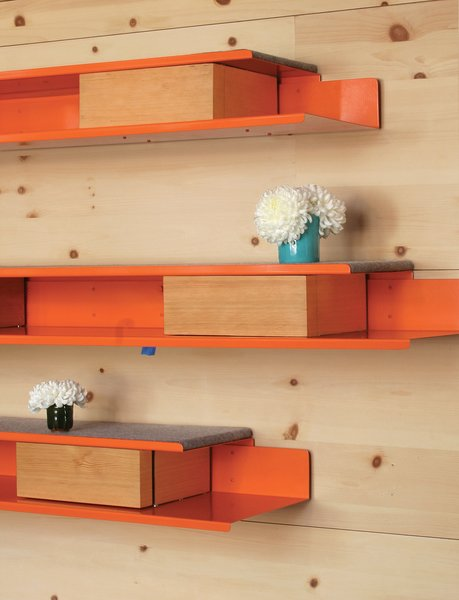 Robertson designed the orange powder-coated-steel shelves and storage units that line the knotty-pine walls. Photo 5 of Courtyard House modern home