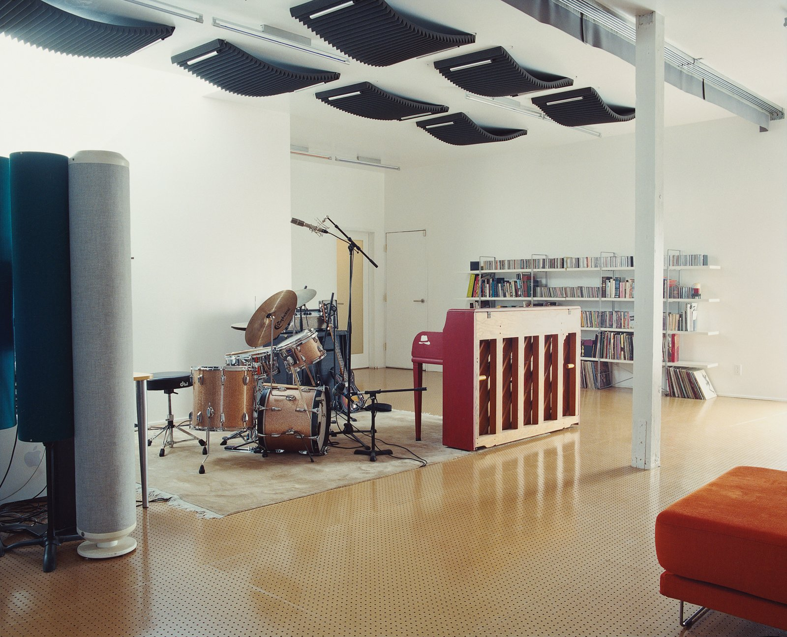 Brill's practice area features a '50s Wurlitzer piano and a mid-'60s Ludwig drum kit. For acoustics, the architect insulated the walls with two layers of Sheetrock stuffed with denim insulation. The floor is made of pegboard—an unusual, albeit cost-effective, material choice.
