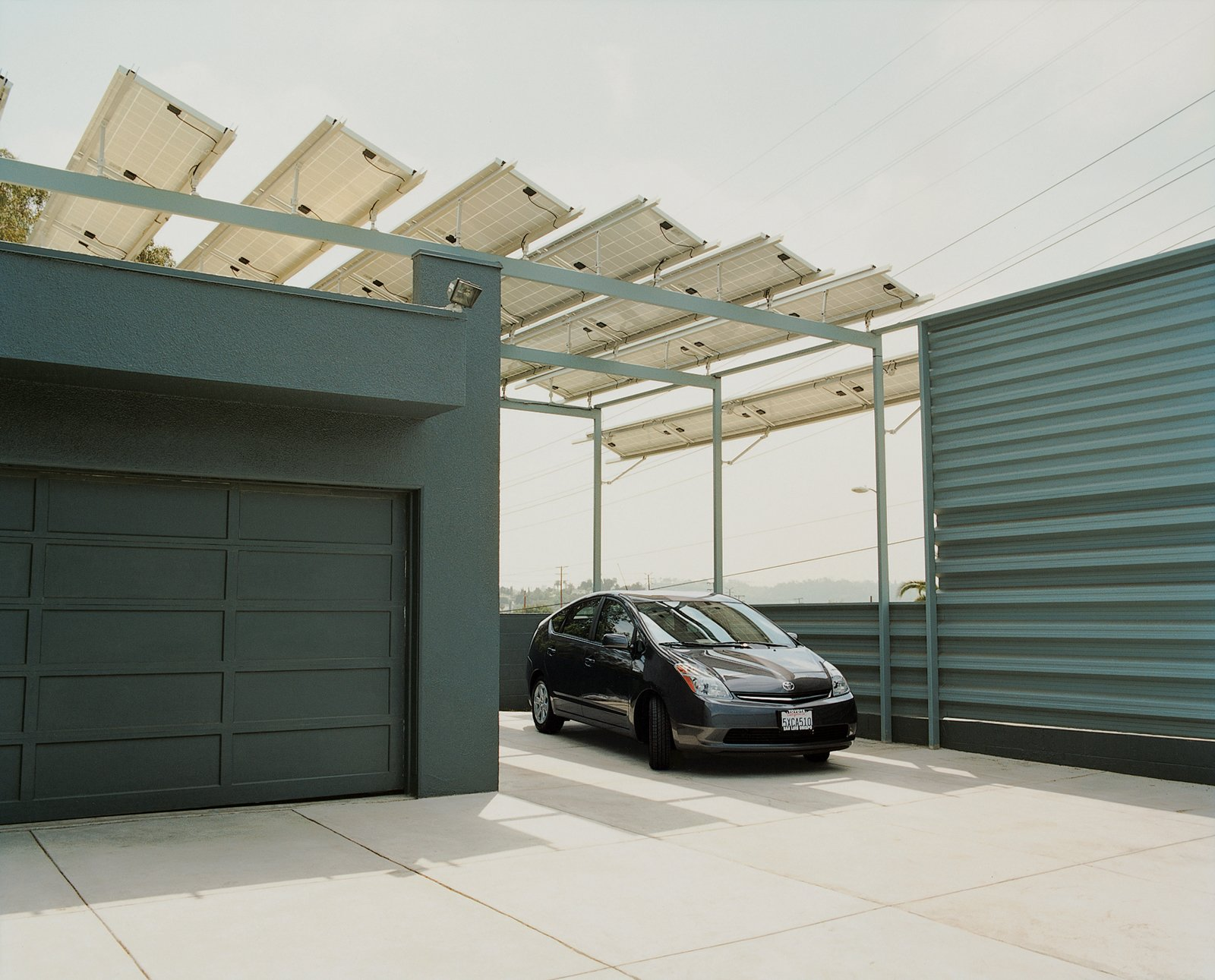 Brill's Prius sits under the solar panels, which supplies the energy for the house's lighting, air-conditioning and hot water.