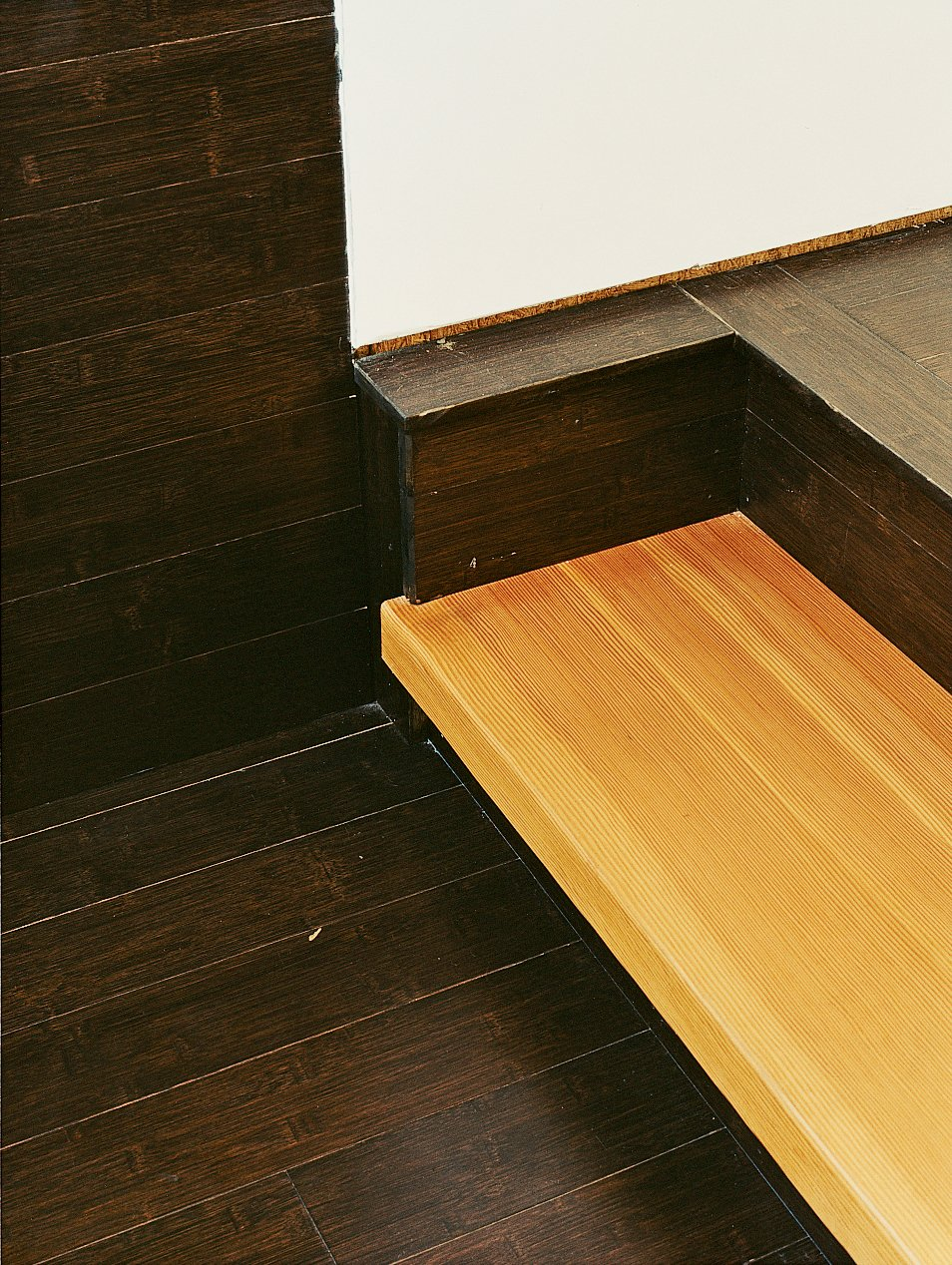 Fir stair treads are cantilevered off the wall with a custom steel support to create an industrial look. Tagged: Staircase and Wood Tread.  Photo 8 of 10 in Gaffney House Dining Room from Leave it to Beavers