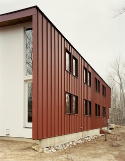 "Leave it to Beavers - Photo 8 of 9 - To avoid constant maintenance issues—after all, ""durability is part of sustainability,"" Gaffney states—the roof is clad in standing seam metal and the siding is composite plastic decking, rather than easily weathered wood."