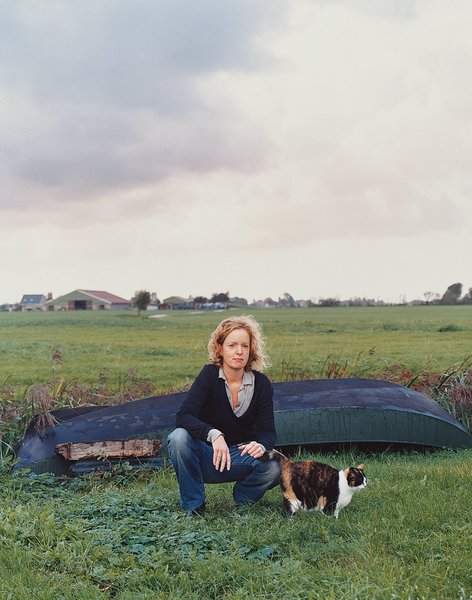 Claudy Jongstra kneels with a family cat in the yard behind her office and home, which she shares with her partner, Claudia Busson, and their two sons, Eabal and Jesk. Behind her is a small dinghy that the family uses to navigate the numerous irrigation canals that traverse the farmlands throughout Friesland. Despite its modest scale, Jongstra's studio has worked on major collaborations with Hella Jongerius,Tord Boontje, Steven Holl, andRem Koolhaas, in addition tofashion design for Alexander van Slobbe and costume work for Star Wars: The Phantom Menace.