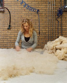 Shear Talent - Photo 2 of 13 - A felt maker lays Drenthe wool and raw silk onto a large table lined with bubble wrap.