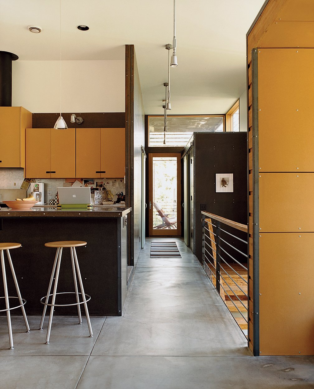 Oiled concrete floors inform the interior of the Stanwood residence. Tagged: Kitchen, Concrete Floor, and Pendant Lighting.  Photo 9 of 10 in Jackson, WY