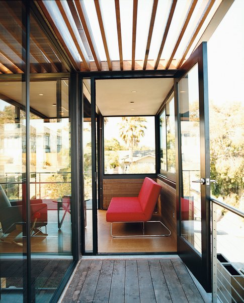 On the second floor, an open balcony of FSC-certified tigerwood with a cedar trellis leads into a light-filled study/guest bedroom.
