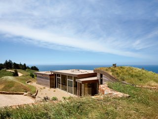 Big Sur: Going Coastal - Photo 1 of 6 - Architect Mary Ann Schicketanz created a 1,900-square-foot home in Big Sur, California, that hugs its hillside site.