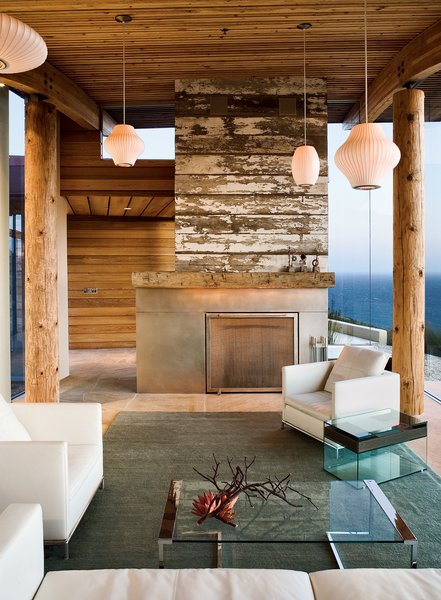 A reclaimed-wood fireplace is a defining feature in the living room.