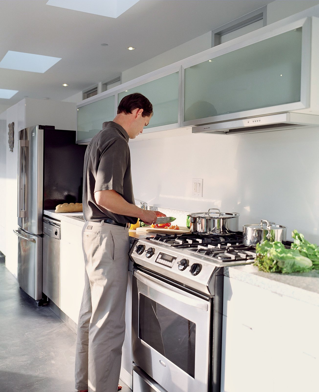 Reitz in the kitchen, which is outfitted with efficient fluorescent lighting and Energy Star appliances. Taking His Own Advice - Photo 3 of 4