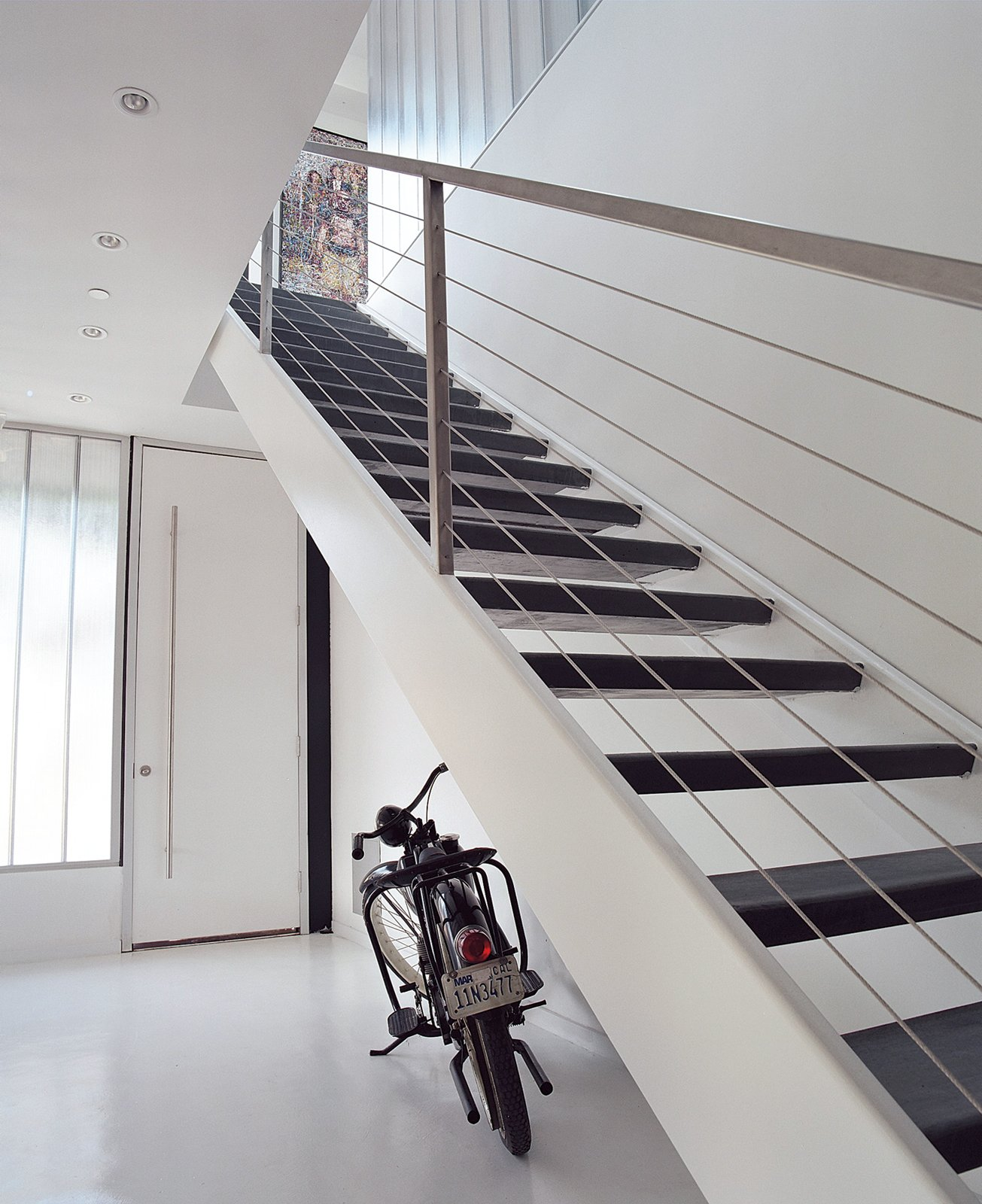 The home's entryway features fly-ash concrete floors and stairs cut from recycled steel. 190+ Best Modern Staircase Ideas by Dwell