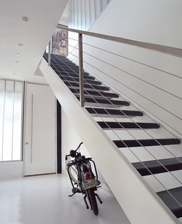 Taking His Own Advice - Photo 4 of 4 - The home's entryway features fly-ash concrete floors and stairs cut from recycled steel.