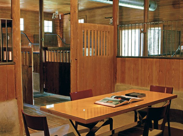 The largest stall (below), formerly used for washing thousand-pound animals, was the perfect size for a meeting room.