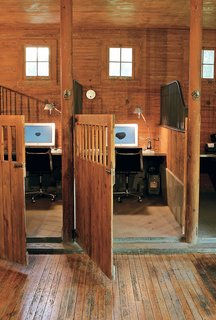 The stalls provide the same demarcated, cozy space for concentration as a cubicle, but the effect is warm and rich rather than garish and chintzy.
