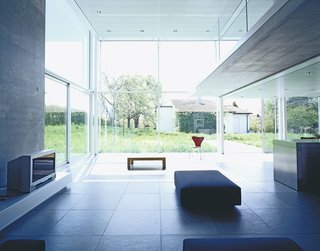A view toward the garden from the living room (right) gives perspective to the double-height space.