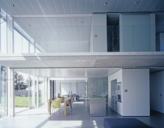 An electronically controlled louver shading system protects the glass façade of the kitchen, office, and upstairs open-plan bedroom from the sun.
