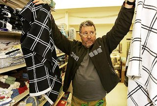 Hollywood, CA - December 04, 2008:<br><br>Designer Philippe Starck shops with his wife Jasmine Starck and daughter Ara at a Big Lots store in Hollywood. Philippe Starck is a designer of iconic furniture, products and interiors.<br><br>(Al Seib  / Los Angeles Times)